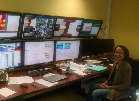Allison Beese, assistant professor of materials sciences and engineering, sits in front of the control panel