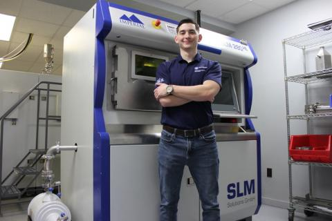 Joseph Sinclair at Imperial Machine & Tool Co. with a SLM 280HL Metal 3D-Printer.