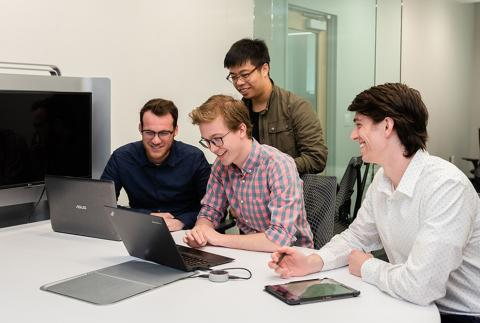 Jason Munro, a doctoral student in materials science and engineering, center, says he works in the field of computational materi
